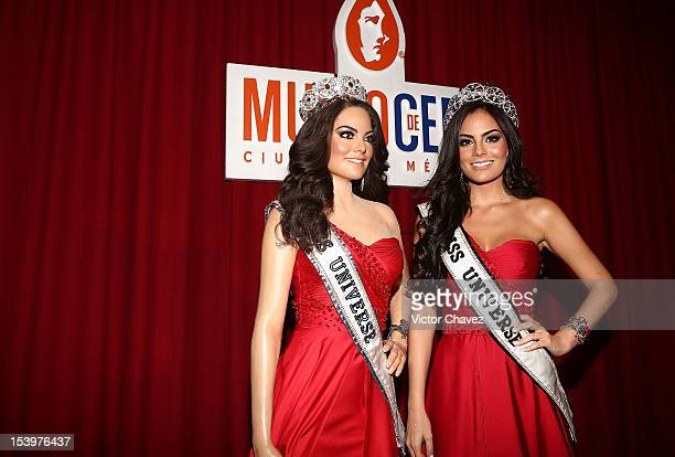 Former Miss Universe 2010 Ximena Navarrete poses next to a wax figure of herself after its unveiling at Mexico City wax museum on October 11 2012 in...