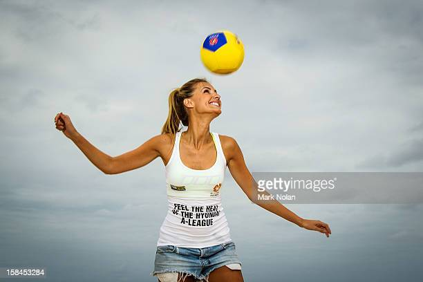 Former Miss Universe Australia Laura Dundovic practices her skills during the FFA Summer Football launch at Maroubra Beach on December 17 2012 in...