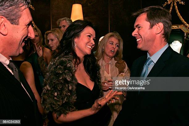 Former Miss Universe Bui Simon center talking with Jim Seuss Harry Winston President left at the opening party of Harry Winston America's premier...