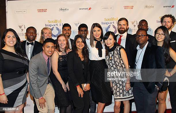 Former Miss Universe Gabriela Isler poses for a picture with Resolution Fellows during The Resolution Project's Resolve 2015 Gala at The Harvard Club...