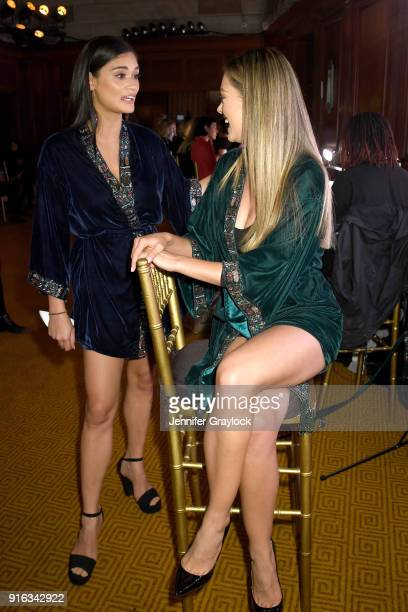 Former Miss Universe Pia Wurtzbach and Miss Universe 2017 DemiLeigh NelPeters prepares backstage during the NYFW Sherri Hill Runway Show on February...
