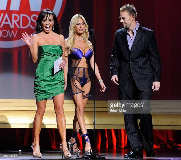 Former Miss USA and adult film actress Kelli McCarty, actress and model Shauna Sand and adult film actor Erik Everhard present an award during the...