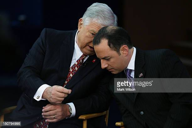 Former Mississippi Gov Haley Barbour and RNC Chairman Reince Priebus prepare to give an interview ahead of the Republican National Convention at the...