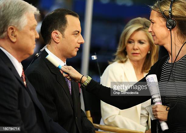Former Mississippi Gov Haley Barbour RNC Chairman Reince Priebus and US Rep Marsha Blackburn prepare to give an interview ahead of the Republican...