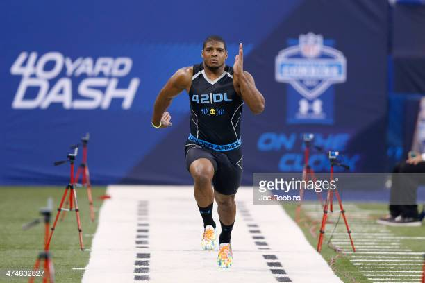 Former Missouri defensive lineman Michael Sam runs the 40yard dash during the 2014 NFL Combine at Lucas Oil Stadium on February 24 2014 in...