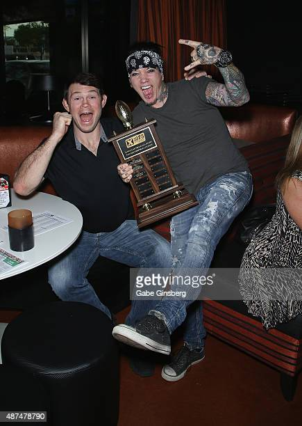 Former mixed martial artist Forrest Griffin and guitarist Dj Ashba of SixxAM attend Touchdown for Charity's celebrity fantasy football draft at Born...