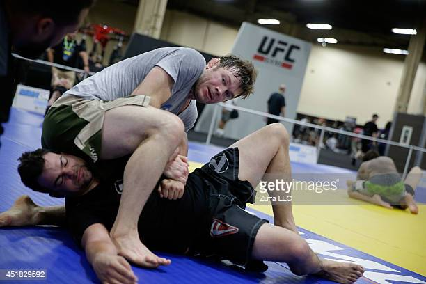 Former mixed martial artist Forrest Griffin instructs martial arts participants during the UFC Fan Expo 2014 during UFC International Fight Week at...