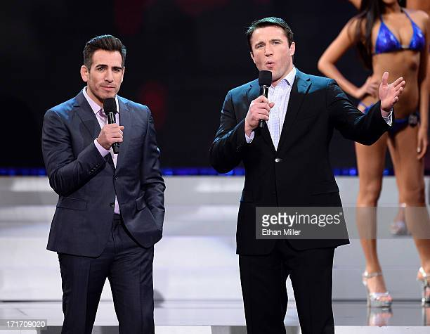 Former mixed martial artist Kenny Florian and mixed martial artist Chael Sonnen host the 17th annual Hooters International Swimsuit Pageant at The...