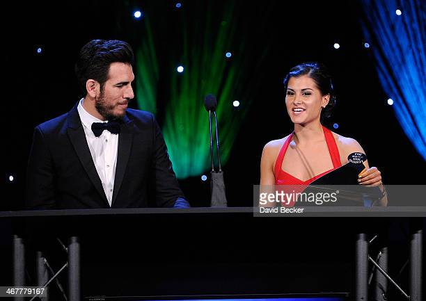 Former mixed martial artist Kenny Florian and television host Megan Olivi present the Leading Man of the Year award at the sixth annual Fighters Only...
