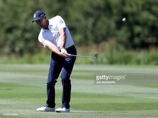 Former MLB athlete John Smoltz hits from the third hole during the final round of the American Century Championship at Edgewood Tahoe South golf...