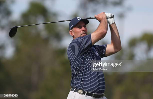 Former MLB pitcher John Smoltz watches his tee shot on the fourth hole during the third round of the Diamond Resorts Tournament of Champions at...