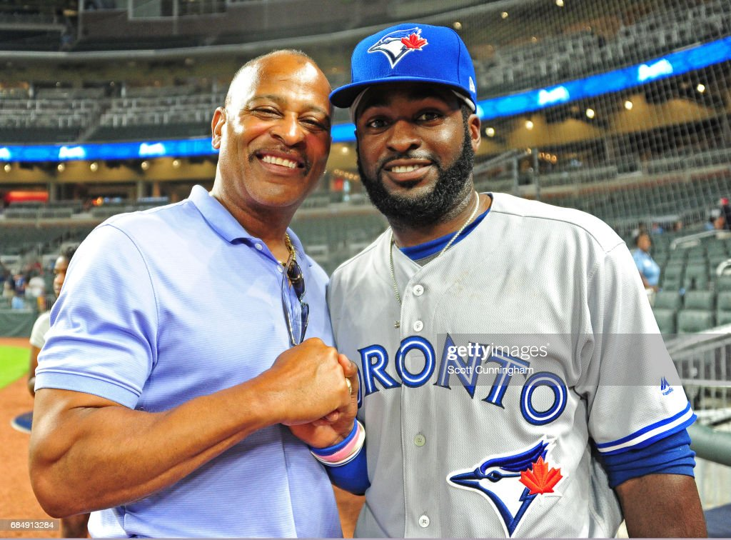 Former MLB player Dwight Smith poses for a photograph with his son, Dwight Smith, Jr. #15 of the Toronto Blue Jays after the game against the Atlanta Braves at SunTrust Park on May 18, 2017 in Atlanta, Georgia.