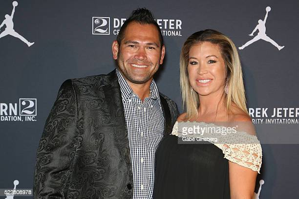 Former MLB player Johnny Damon and his wife Michelle Damon arrive at the Liquid Pool Lounge for the kickoff of Derek Jeter's Celebrity Invitational...