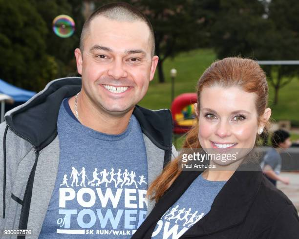 Former MLB Player Nick Swisher and Actress JoAnna Garcia Swisher attend the Power Of Tower run/walk at UCLA on March 11 2018 in Los Angeles California
