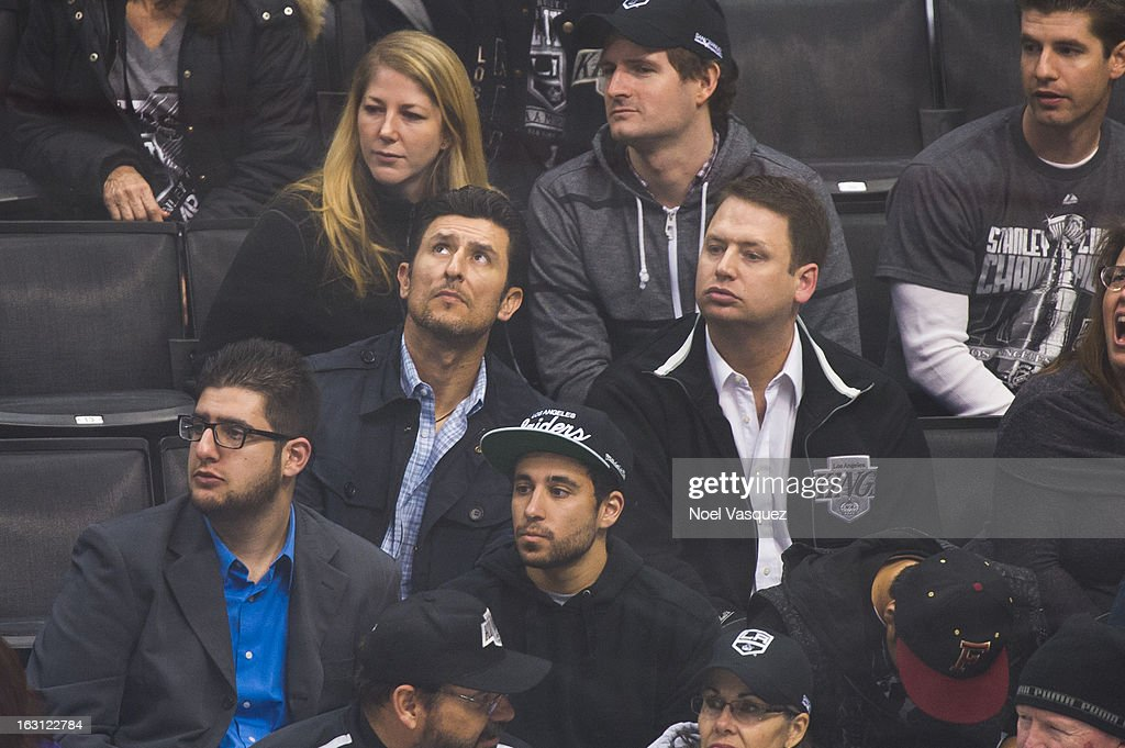 Former MLB player Nomar Garciaparra (C) attends a hockey game between the Nashville Predators and Los Angeles Kings at Staples Center on March 4, 2013 in Los Angeles, California.