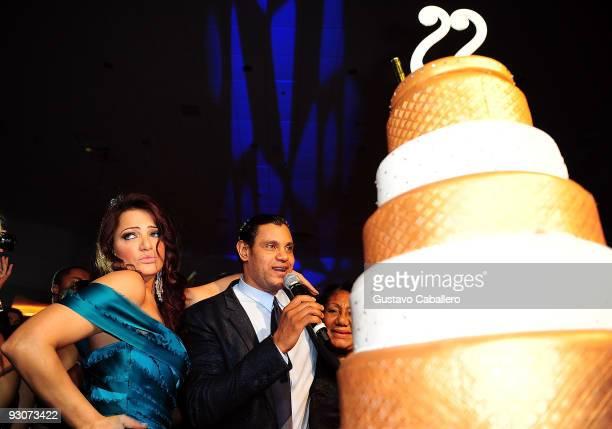 Former MLB player Sammy Sosa and wife Sonia Sosa cut the cake at Sammy Sosa's birthday party at Fontainebleau Miami Beach on November 14 2009 in...