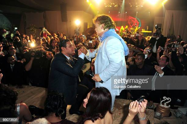 Former MLB player Sammy Sosa goes on the table to greet Juan Gabriel that just performed for Sammy Sosa's birthday party at Fontainebleau Miami Beach...