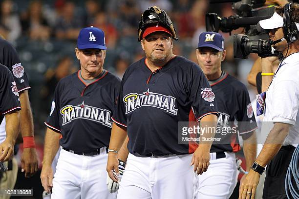Former MLB players Gary Carter John Kruk and Paul Molitor during the MLB All Star Game Celebrity Softball Game at Angels Stadium of Anaheim on July...