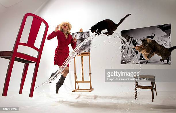 Former model actor and muse of Salvador Dali Amanda Lear is photographed for Paris Match in a reconstruction of 'Dali Atomicus' the famous image...