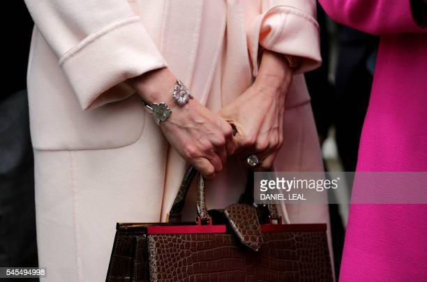 Former model Christina Estrada holds her handbag outside London's High Court on July 8 after she was awarded Friday a GBP 53m cash settlement in a...
