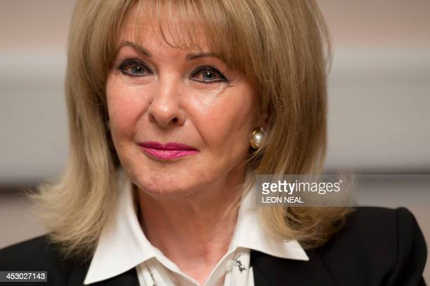 Former model Mandy RiceDavies is pictured at a press conference in London on December 2 to launch lawyer Geoffrey Robertson's book entitled Stephen...