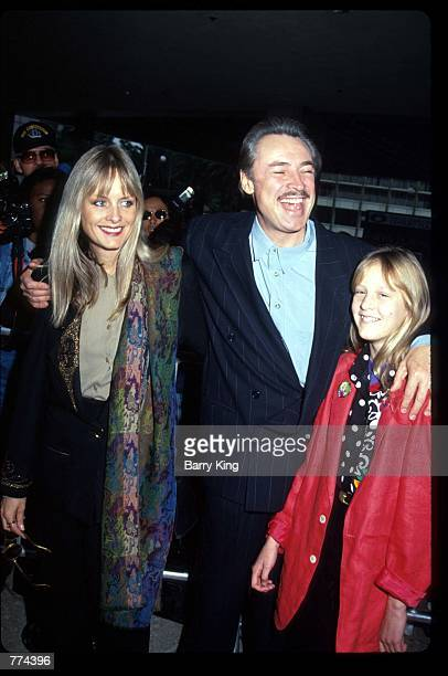 Former model Twiggy arrives with her husband Leigh Lawson and daughter Carly Whitney at the premiere of Hook December 8 1991 in Los Angeles CA The...