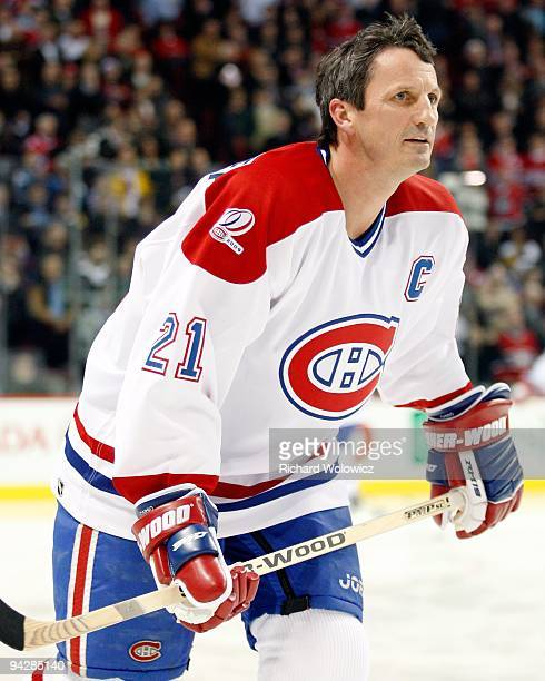 Former Montreal Canadien Guy Carbonneau skates during the Centennial Celebration ceremonies prior to the NHL game between the Montreal Canadiens and...