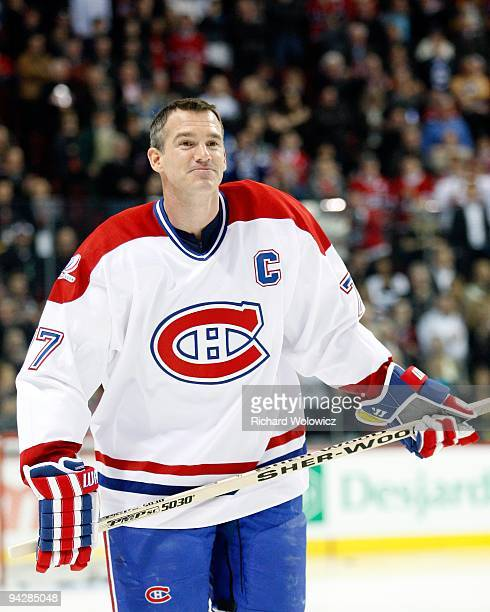 Former Montreal Canadien Pierre Turgeon skates during the Centennial Celebration ceremonies prior to the NHL game between the Montreal Canadiens and...