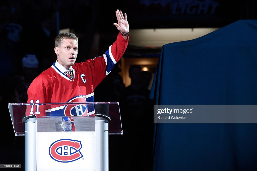 Former Montreal Canadien player Saku Koivu speaks to fans during a ceremony honouring the former team captain prior to the NHL game between the Montreal Canadiens and the Anaheim Ducks at the Bell Centre on December 18, 2014 in Montreal, Quebec, Canada.