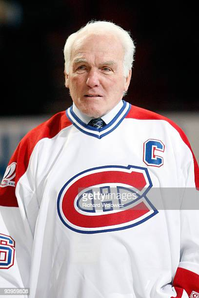 Former Montreal Canadiens Henri Richard attends the Centennial Celebration ceremonies prior to the NHL game between the Montreal Canadiens and Boston...