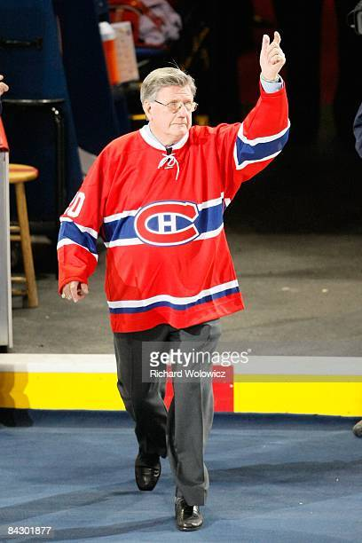 Former Montreal Canadiens player Phil Goyette waves to fans during pregame ceremonies before the game between the Toronto Maple Leafs and the...