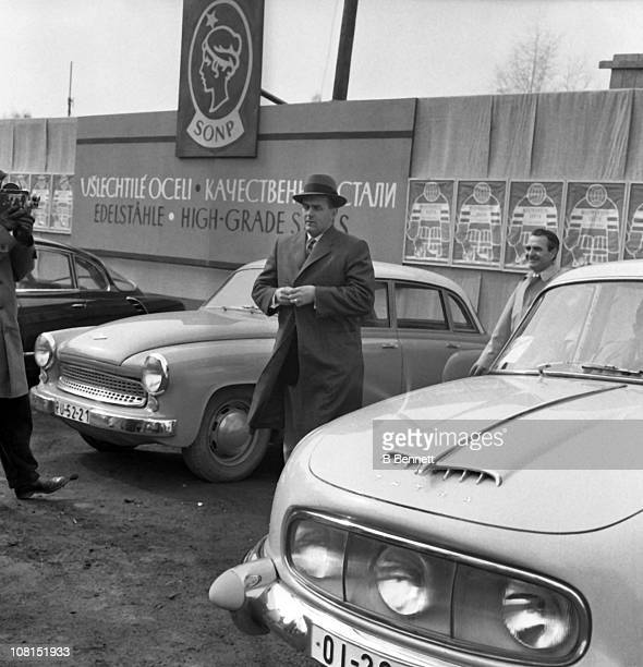 Former Montreal Canadiens star Maurice Richard walks through a car lot circa 1960's in the former Czechoslovakia