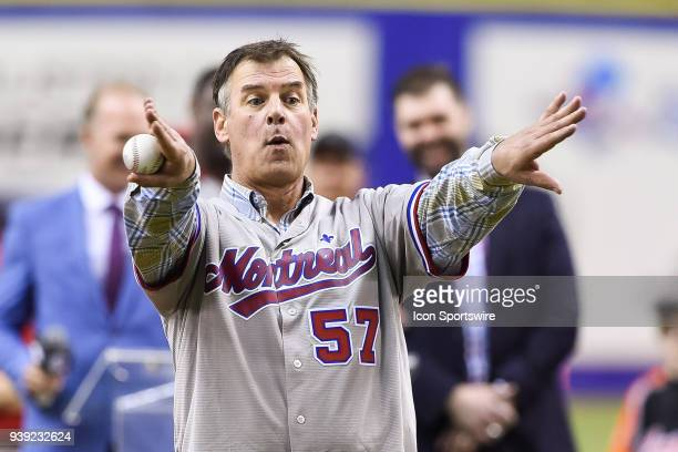 Former Montreal Expos pitcher John Wetteland signals the crowd to move away before the honorary first pitch before the St Louis Cardinals versus the...
