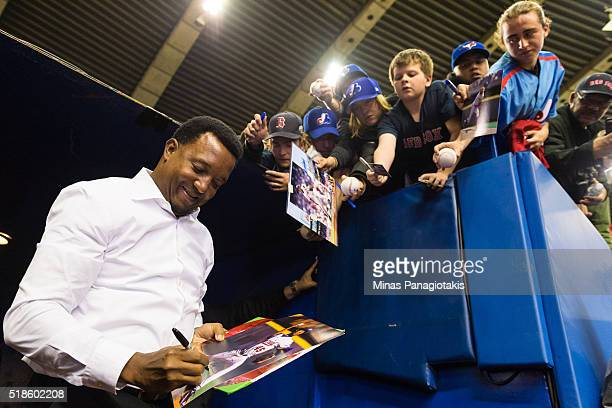 Former Montreal Expos pitcher Pedro Martinez signs autographs for fans prior to the MLB spring training game between the Toronto Blue Jays and the...