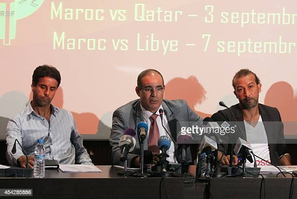 Former Moroccan football players Said Chiba and Mustapha Hadji and national team manager Badou Ezzaki hold a press conference on August 28 2014 in...
