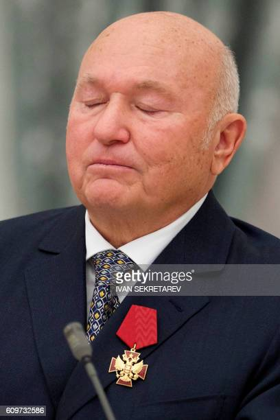 Former Moscow Mayor Yuri Luzhkov reacts after he was awarded by Russian President during an awarding ceremony at the Kremlin in Moscow on September...