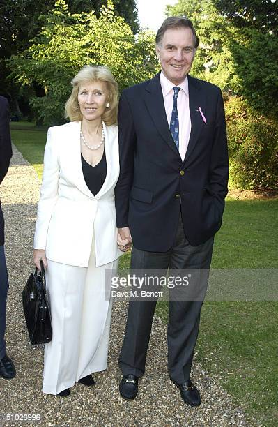 Former MP Jonathan Aitken and Elizabeth Harris attend the Kit-Kat Club garden party, founded by Ghislaine Maxwell, to help women in commerce and...