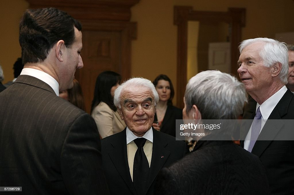 Former MPAA President Jack Valenti (2nd L) speaks with Senators Rick Santorum (L)(R-PA), Thad Cochran (R)(R-MS) and Cochran's director of special services Kay Webber during a reception held at the MPAA by Friends of the Global Fight April 4, 2006, in Washington, DC.