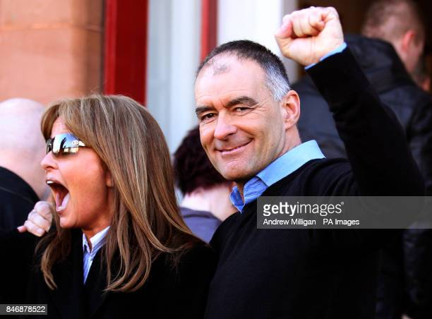 Former MSP Tommy Sheridan accompanied by his wife Gail salutes well wishers as he arrives home in Glasgow after leaving Castle Huntly Prisonnear...
