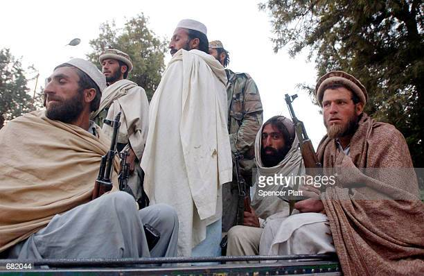Former mujahideen meet outside of the governor's house November 16, 2001 in the recently acquired city of Jalalabad, Afghanistan, which fell from...