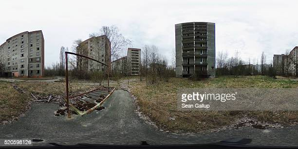 Former multistorey apartment buildings stand on April 9 2016 in Pripyat Ukraine Pripyat built in the 1970s as a model Soviet city to house the...
