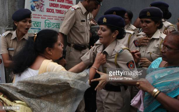 Former Mumbai mayor of Shiv Sena Vishakha Raut grab the collar of lady constable during the protest against Ajit Pawar