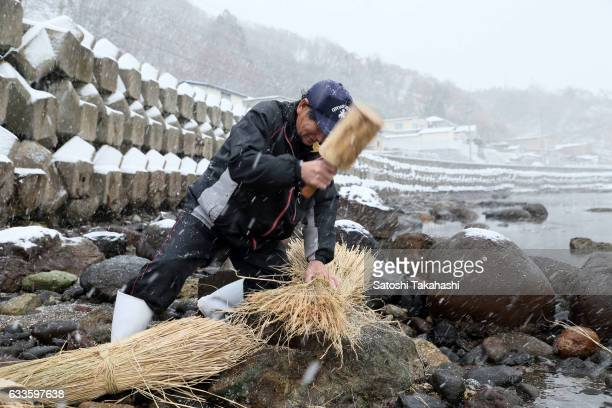 A former Namahage player Tsutomu Takakuwa who hits the wooden hammer to soften straw to makes Kede which is traditional straw garment of Namahage on...