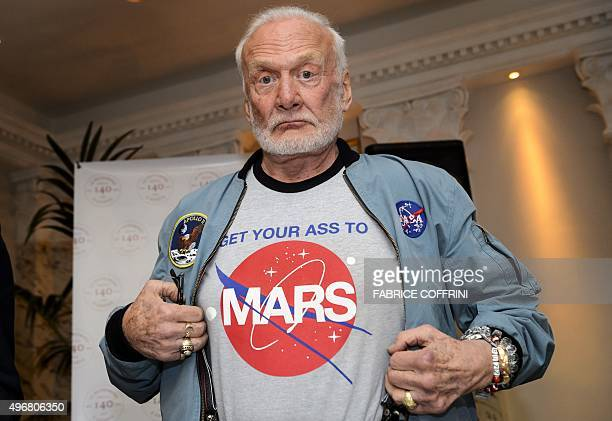 Former NASA astronaut Buzz Aldrin shows the tshirt he wears promoting Mars exploration on November 12 2015 in Geneva Aldrin attended a press...