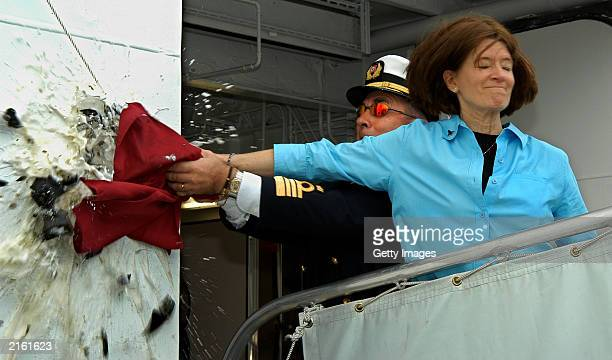Former NASA astronaut Sally Ride aided by Carnival Cruise Lines' Captain Carlo Queirolo smashes a bottle of champagne against the side of the cruise...