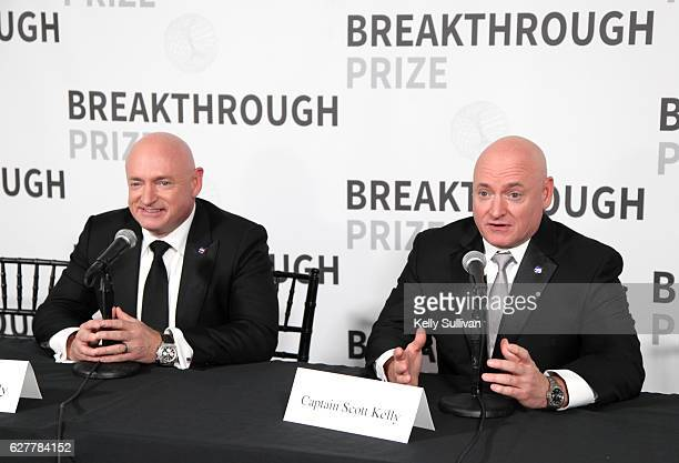 Former NASA astronauts Mark Kelly and Scott Kelly speak during the 2017 Breakthrough Prize at NASA Ames Research Center on December 4 2016 in...