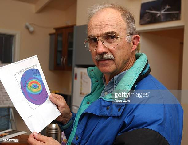 Former NASA research pilot Einar Enevoldson who will fly with Steve Fossett holds a satelite map of Antarctic winds which the pair hope will lift...