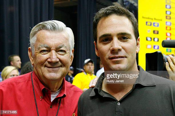 Former NASCAR Champion Bobby Allison stands with Jimmie Johnson driver of the Lowe's Chevrolet during the NASCAR Nextel Pit Crew Challenge on May 16...