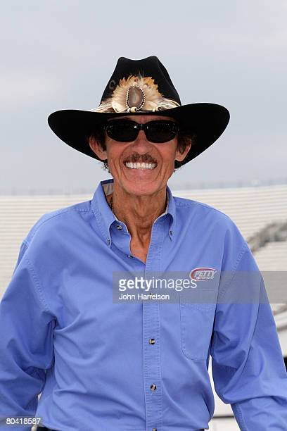 Former NASCAR Champion Richard Petty walks in the garage area during practice for the NASCAR Sprint Cup Series Goody's Cool Orange 500 at...
