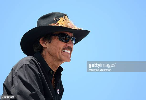 Former NASCAR champion, Richard Petty, watches during practice for the NASCAR Nextel Cup Series Lenox Industrial Tools 300 at New Hampshire...